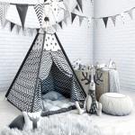Wigwam with a mattress pillows fur skins baskets flags and deer